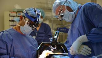 Girish Nair and Andrew Evans in surgery