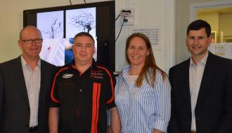 A/Prof Peter Mitchell (far left) and  Dr Bruce Campbell (far right) with Sam and Sally Kalogiannopoulos. Sam was  participant in the EXTEND-IA trial.